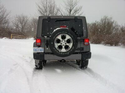 Rear view of Jeep Wrangler Unlimited in the snow