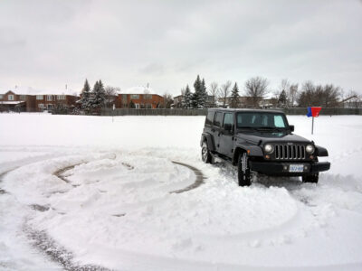 Jeep Wrangler Unlimited making circles in the snow