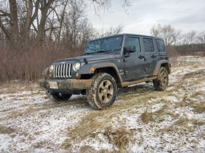 Front view of Jeep Wrangler Unlimited in mud