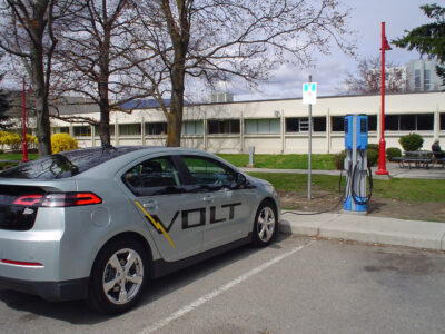 Chevrolet Volt stops at an EV charging station